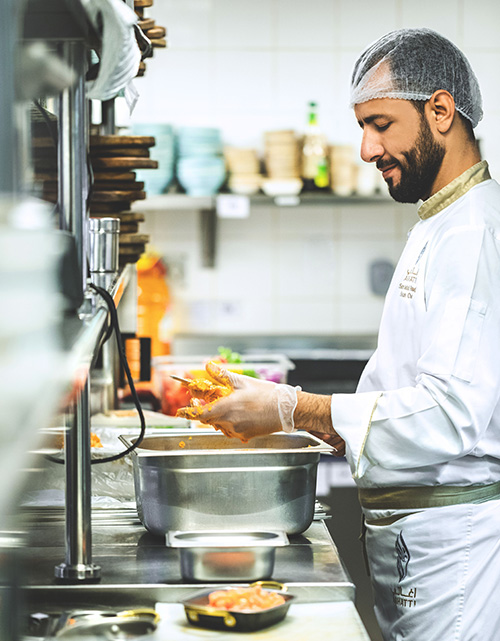Chef preparing food. Photo by Eiliv-Sonas Aceron on Unsplash.