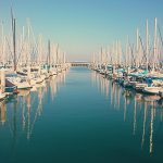 Sailboats docked at marina. Photo by Layton Diament on Unsplash.